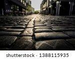 black cobbled stone road...   Shutterstock . vector #1388115935