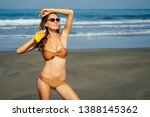young beautiful sexy tanned... | Shutterstock . vector #1388145362