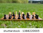 chess pieces on board in green... | Shutterstock . vector #1388220005