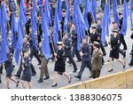 WARSAW, POLAND - MAY 03, 2019: Military parade with NATO flags, celebration of Polish Constitution day, 20th anniversary in NATO, 15th anniversary in EU. - stock photo