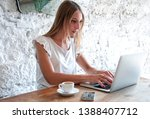 young woman working with... | Shutterstock . vector #1388407712