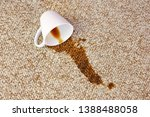 cup of coffee fell on carpet.... | Shutterstock . vector #1388488058