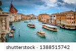 Small photo of Water taxi and vaporetto boats traverse the Grand Canal in Venice, Italy, faces and logos blurred for commercial use