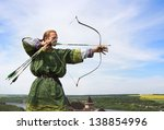 young archer with bow and... | Shutterstock . vector #138854996