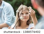 cute girl holding stick with... | Shutterstock . vector #1388576402