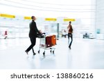 traveling man with a trolley car at the airport - stock photo