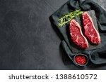 Raw beef ramp steak. Black background, top view