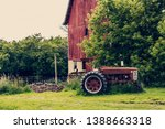 Old Tractor With Red Barn