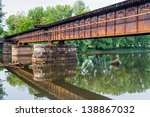 A Rusty Railroad Bridge Spans...