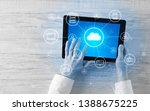 hand touching tablet with cloud ... | Shutterstock . vector #1388675225