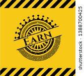 earn grunge warning sign emblem....   Shutterstock .eps vector #1388700425