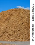 Wood Chips Piles At A Blue Sky