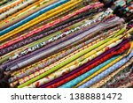 multicolored textiles on the... | Shutterstock . vector #1388881472
