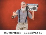 senior crazy man with boombox... | Shutterstock . vector #1388896562