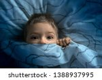 boy in bed with his eyes open.... | Shutterstock . vector #1388937995