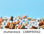 heap of of colorful pills... | Shutterstock . vector #1388950562