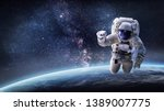Astronaut In Outer Space Over...