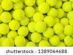 Lots of vibrant tennis balls ...