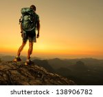 hiker with backpack standing on ... | Shutterstock . vector #138906782