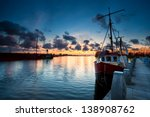 Fishing Ships At Sunset In...