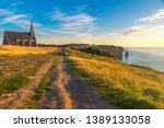 etretat  normandy  france.... | Shutterstock . vector #1389133058