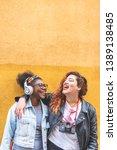 two teenage latin girls having...   Shutterstock . vector #1389138485