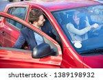 handsome man in suit getting in ...   Shutterstock . vector #1389198932