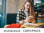 Small photo of Happy hipster girl feeling shocked from received email with information about university session connected to 4g wireless on mobile phone, surprised female student messaging with scholar via app