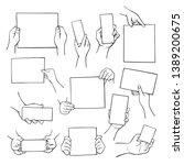 hands holding empty paper...   Shutterstock .eps vector #1389200675