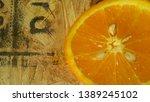 juicy orange on a wooden board. | Shutterstock . vector #1389245102