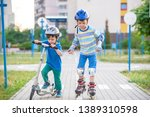 kid boy on roller skates and... | Shutterstock . vector #1389310598
