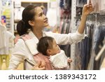 asian mother with her baby in... | Shutterstock . vector #1389343172