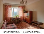 Interior of typical soviet style apartment. Old furniture and retro design