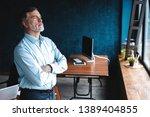 mature businessman in a... | Shutterstock . vector #1389404855