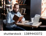 young successful bearded... | Shutterstock . vector #1389443372