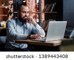 businessman bearded man in a... | Shutterstock . vector #1389443408