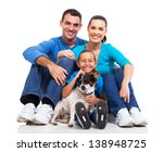 Stock photo portrait of cute family sitting on floor with their pet dog isolated on white 138948725