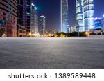 asphalt race track and modern... | Shutterstock . vector #1389589448