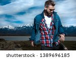 young casual bearded man moves... | Shutterstock . vector #1389696185