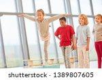 girl trains balance on balance...   Shutterstock . vector #1389807605