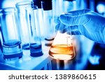 flask in scientist hand with... | Shutterstock . vector #1389860615