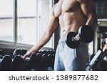 fitness asian man doing... | Shutterstock . vector #1389877682