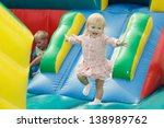 little girl at the trampoline   Shutterstock . vector #138989762
