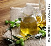bottles of olive oil with... | Shutterstock . vector #1390017512