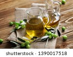 bottles of olive oil with... | Shutterstock . vector #1390017518
