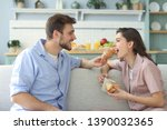 happy young couple in pajamas... | Shutterstock . vector #1390032365