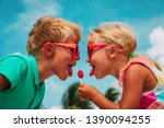 happy little girl and boy with... | Shutterstock . vector #1390094255