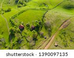 Aerial view of a countryside homestead houses in the mountains by drone