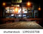 Stock photo desk of free space for your decoration and blurred background of bar 1390103708