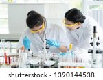 female  scientists are... | Shutterstock . vector #1390144538